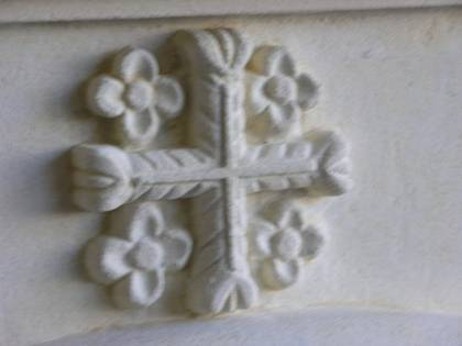 'Christian Cross' with floweret detail, carved in Oamaru Limestone