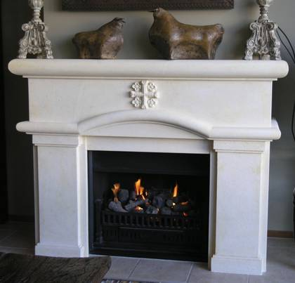 Classical Spanish Colonial designed fireplace with 'Christian Cross' floweret detail, carved in Oamaru Limestone