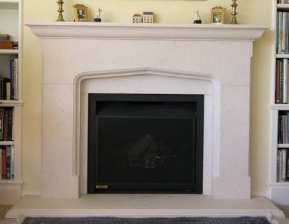 Classical Tudor Arch fire surround, carved in Portuguese Limestone