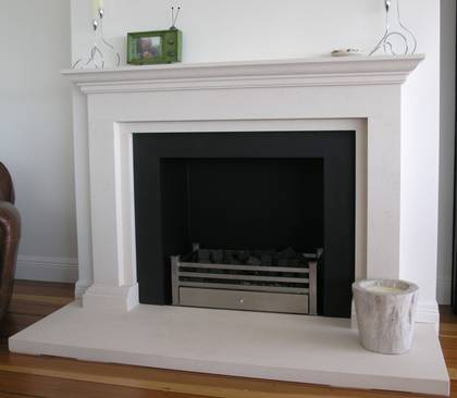 Classical linear styling with carved moulded mantle and foot blocks, carved in Portuguese Limestone