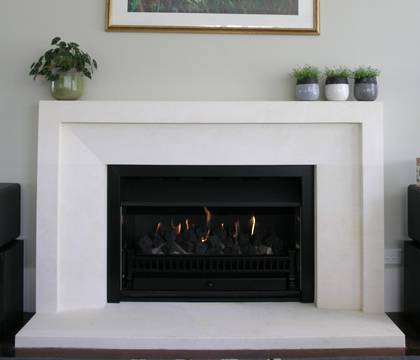 Bevel fireplace with wide border, carved in Oamaru Limestone
