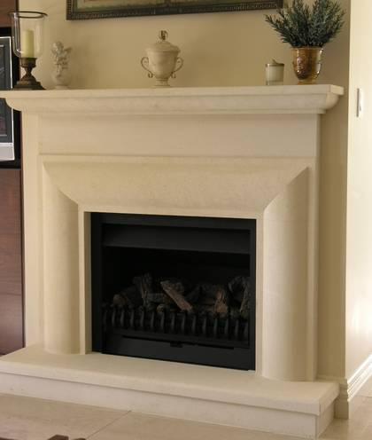 Bolection fireplace surround plain frieze and  moulded mantle, carved in Oamaru Limestone