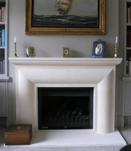 Bolection with carved moulded mantle, in Oamaru Limestone