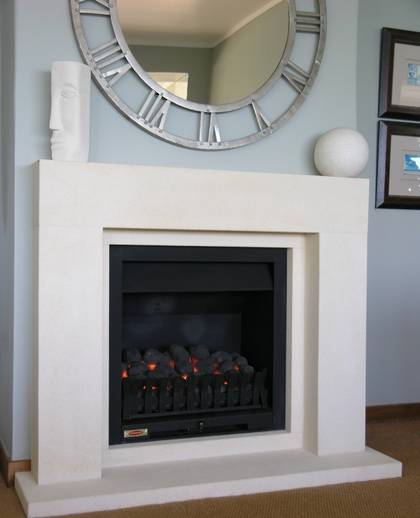 Cubist fireplace in Oamaru Limestone