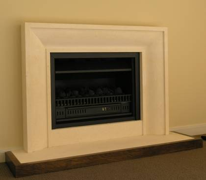 Contemporary internal radiuses fireplace carved in Oamaru Limestone