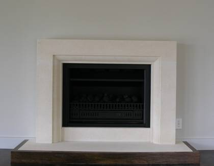 Contemporary styled fireplace carved in Oamaru Limestone with moulding to internal edge
