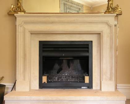 French Louis XIII fireplace carved in Oamaru Limestone with aged patina
