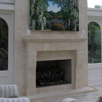 French Provincial fireplace and breast in loggia setting, set into Aged Oamaru Stone wall
