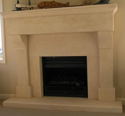 French Provincial fireplace with large block lintel carved in Oamaru Limestone with aged patina