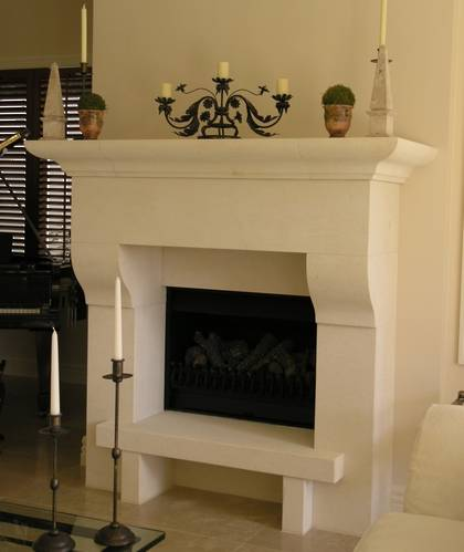 Italianesque styled fireplace mantle with raised hearth carved in Oamaru Limestone