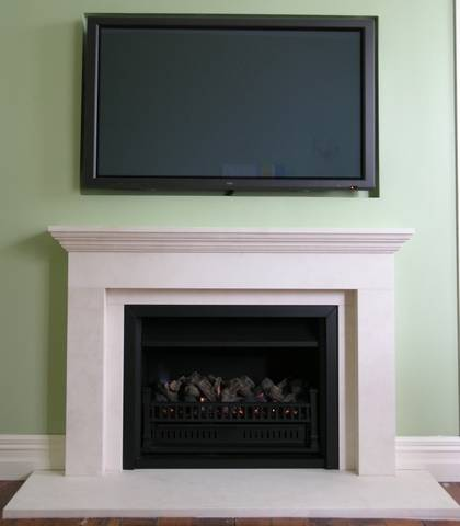 Linear styled fireplace with TV recessed above