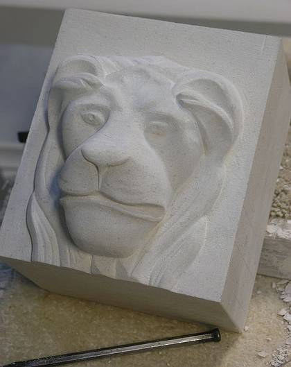 Lions head detail carved in Portuguese Limestone