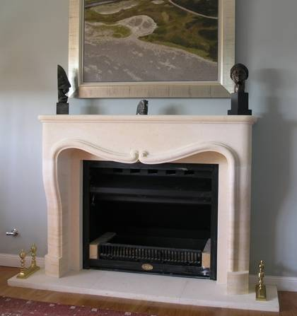 Louis XIV fire surround with central volutes carved in Oamaru Limestone