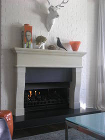 French Provincial inspired fire surround carved in Hinuera stone with optional Bluestone hearth and reveal slips.