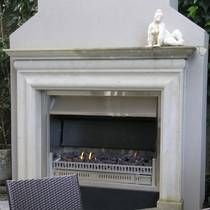 Bolection styled Loggia sized fire surround carved in Hinuera Stone