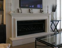 Classical Bolection style with raised hearth carved in Oamaru Limestone