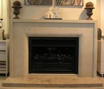 Contemporary fire surround with border and radius to internal edge carved in Hinuera Stone