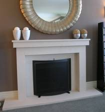 Linear styled fire surround, hearth and reveals carved in Portuguese Limestone
