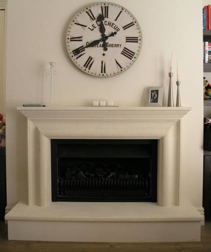 Bolection style fireplace with raised hearth carved in Oamaru Limestone