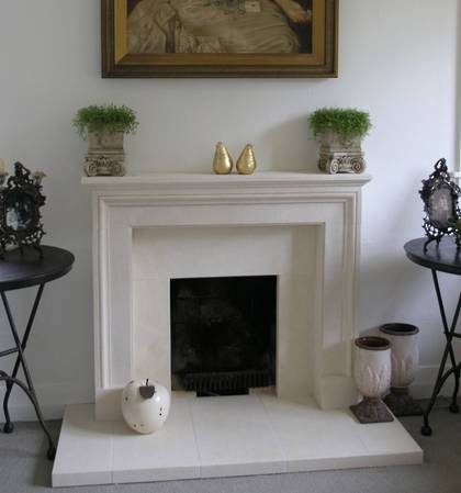 Boutique French fireplace and hearth carved in Oamaru Limestone