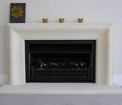 Contemporary fire surround 'connecting curve' design hand carved in Oamaru Limestone