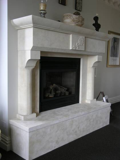 French 'Gothique' fire surround solid raised hearth with Rose carving to lintel