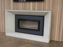 Contemporary Deep bevel mantle and hearth carved in Hinuera Stone.