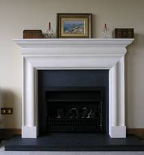 Classical Bolection with Bluestone hearth and firebox trim Carved in Oamaru Limestone