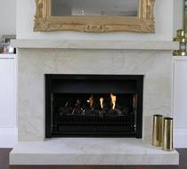 Bevelled fire surround carved in Hinuera Stone