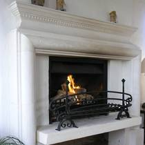 French Louis XIII raised hearth hand carved in Oamaru Limestone with aged and 'distressed' patina finish