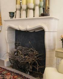 French Louis XIV fireplace hand carved in Oamaru Limestone with aged patina